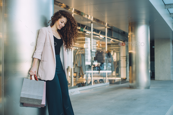 Happy beautiful young redhead woman doing shopping - Stock Photo - Images