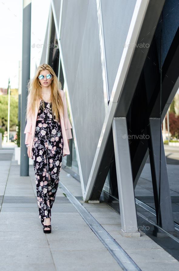 fashion young woman bussineswoman walking with sunglasses on the street - Stock Photo - Images