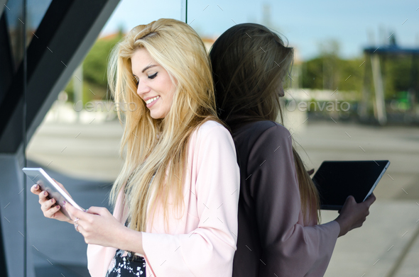 happy young blonde woman smiling with tablet - Stock Photo - Images
