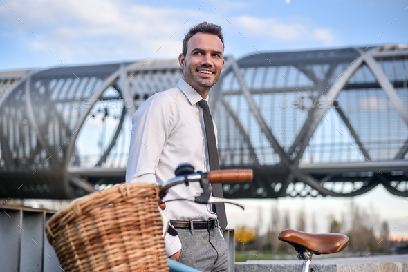 Business man with vintage bicycle by the river - Stock Photo - Images