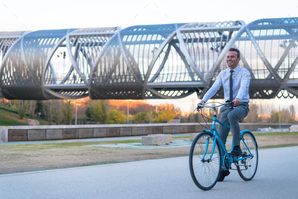 Business man riding a vintage bicycle in the city - Stock Photo - Images