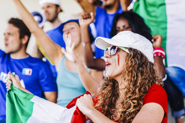 Supporters from Italy at stadium watching the match - Stock Photo - Images