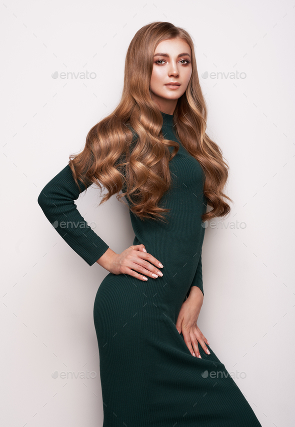Beautiful woman in knitted dress dress - Stock Photo - Images