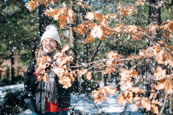 portrait Young pretty woman enjoying and playing with snow in winter - Stock Photo - Images