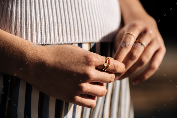 Crop woman hands with rings on the street - Stock Photo - Images