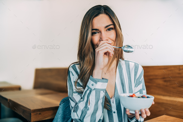 woman close up eating oat and fruits bowl for breakfast - Stock Photo - Images