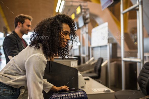 People check-in luggage at the airport - Stock Photo - Images
