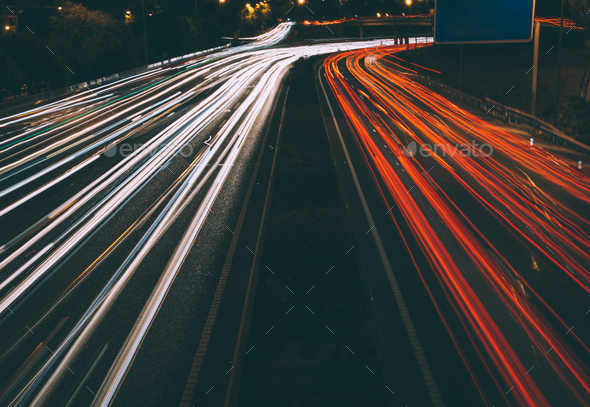 Traffic lights at night on road - Stock Photo - Images