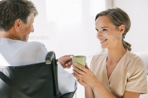 Caring nurse and a woman - Stock Photo - Images