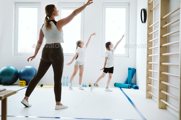 Strechting classes at the school gym - Stock Photo - Images