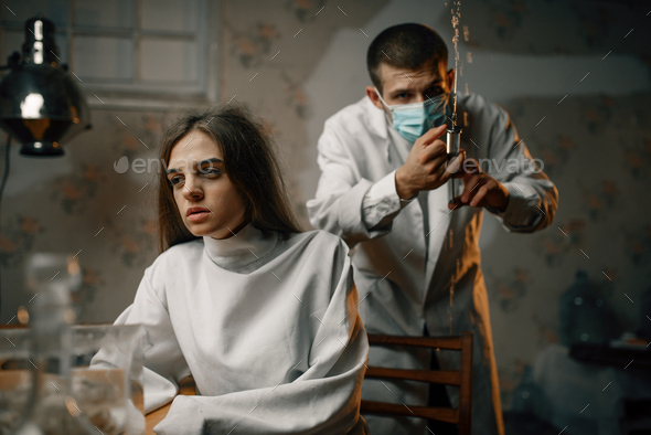 Psychiatrist preparing to give sedative injection - Stock Photo - Images