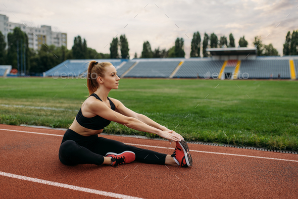 Female runner in sportswear, training on stadium - Stock Photo - Images
