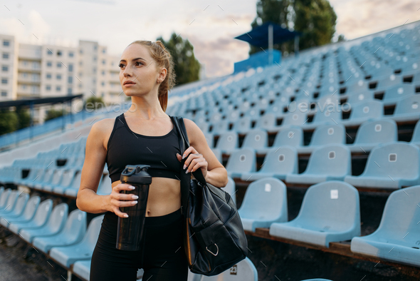 Female runner in sportswear on stadium tribune - Stock Photo - Images