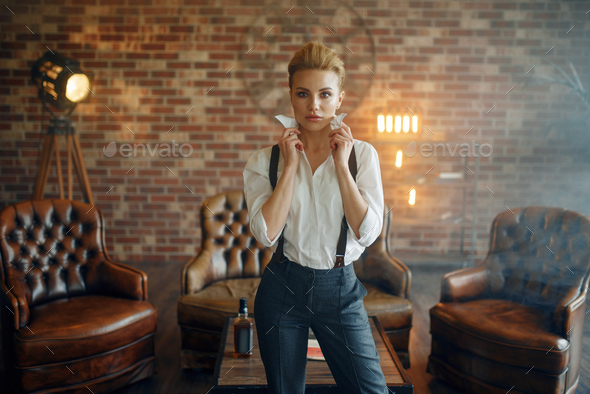 Woman in strict clothes in studio, retro fashion - Stock Photo - Images