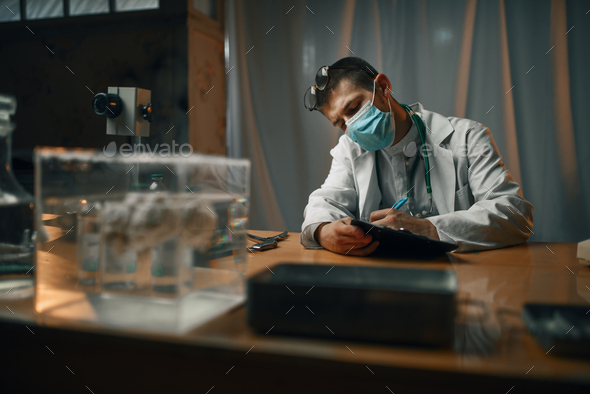 Psychiatrist in mask and glasses, mental hospital - Stock Photo - Images