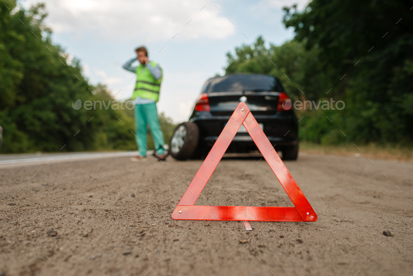 Emergency stop sign, car breakdown, flat tyre - Stock Photo - Images