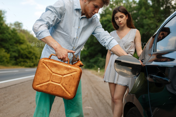 Couple with a canister of gasoline, out of gas - Stock Photo - Images