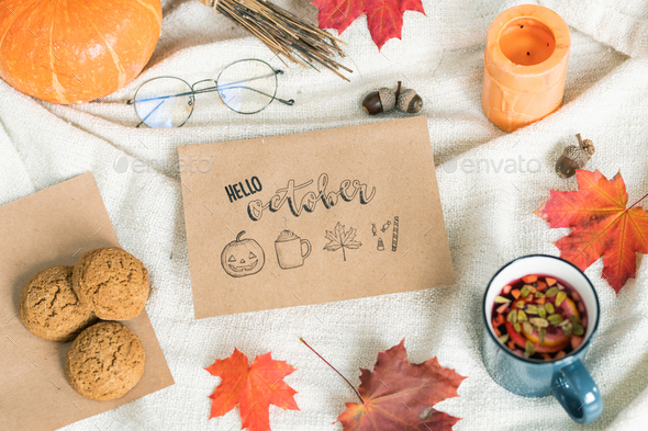 October background with leaves, food and drink, acorns, candle and eyeglasses - Stock Photo - Images