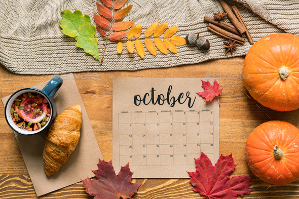 October calendar among fresh pastry with tea, ripe pumpkins, leaves and spices - Stock Photo - Images