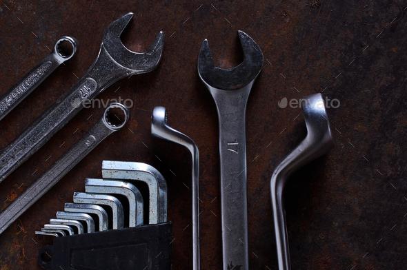 The metallic tool on the rusty metal floor - Stock Photo - Images