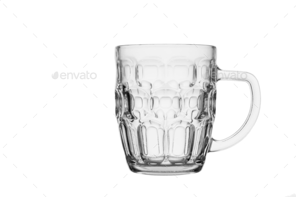 Empty beer glass. Isolated in a white background. Close-up. - Stock Photo - Images