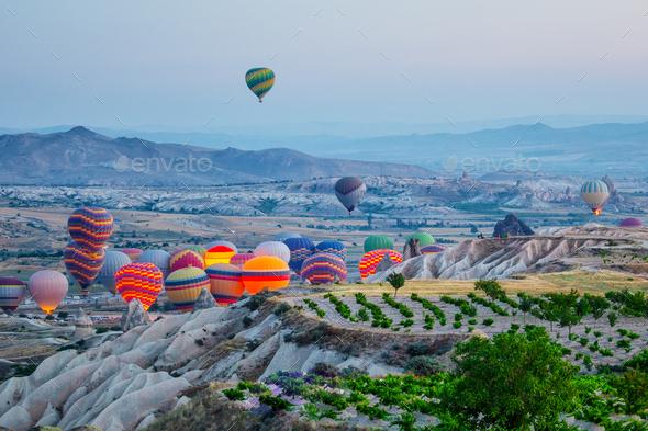 Balloons soar into Cappadocia - Stock Photo - Images