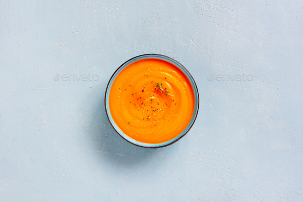 Pumpkin Cream Soup Bowl on the Blue Table - Stock Photo - Images