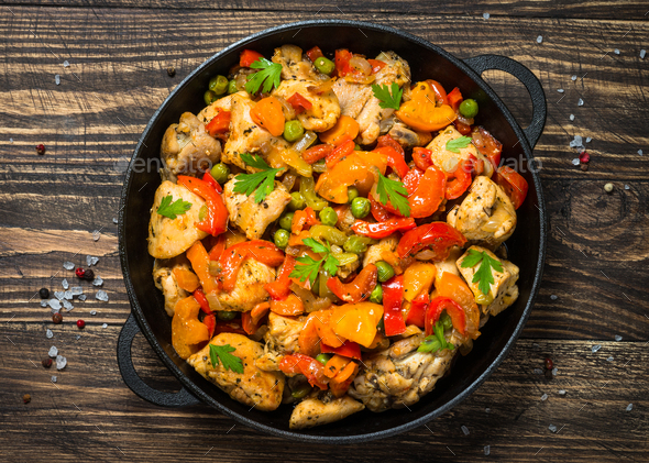 Chicken Stir fry with vegetables on wooden table - Stock Photo - Images