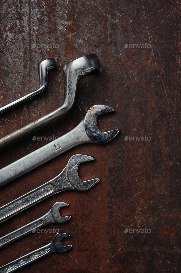 Metallic tools on the rusty metal floor - Stock Photo - Images