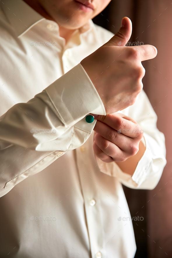 Elegant young fashion man dressing up for wedding celebration. - Stock Photo - Images