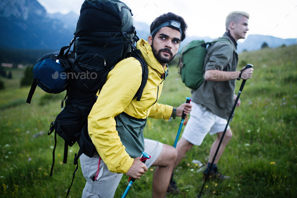 Man traveling with backpack hiking in mountains - Stock Photo - Images