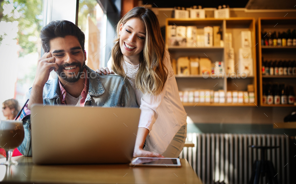 Young couple or college student using laptop computer notebook work together - Stock Photo - Images