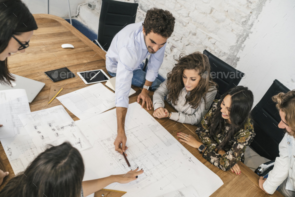 Young team of coworkers making great work discussion in modern c - Stock Photo - Images