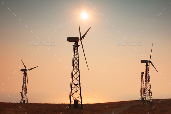 Wind generator on the background of the sunset sky - Stock Photo - Images