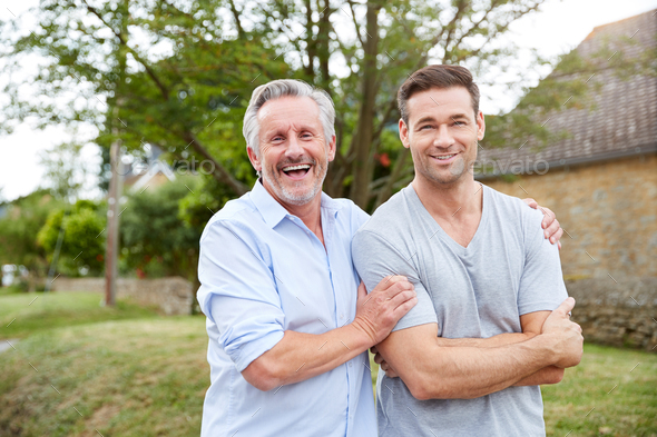 Portrait Of Senior Father With Adult Son Walking Along Country Road Together - Stock Photo - Images