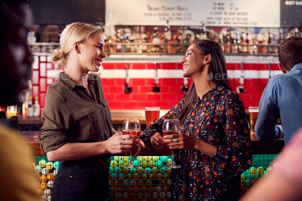 Two Women Meeting For Drinks And Socializing In Bar After Work - Stock Photo - Images