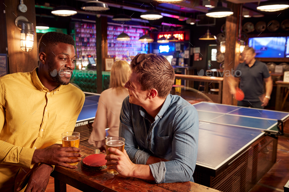 Interior Of Bar With Customers Drinking And Playing Table Tennis - Stock Photo - Images