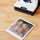 Vintage Instant Film Camera With Print Of Senior Parents And Adult Offspring Posing For Selfie - PhotoDune Item for Sale
