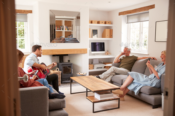 Family With Senior Parents And Adult Offspring Relaxing In Lounge At Home Together - Stock Photo - Images