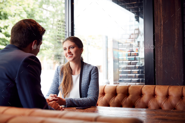 Business Couple On Date Meeting For Drinks And Socializing In Bar After Work - Stock Photo - Images