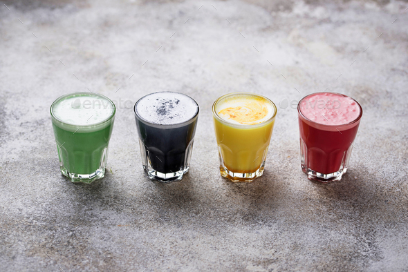 Super lattes with charcoal, beetroots, matcha and turmeric - Stock Photo - Images