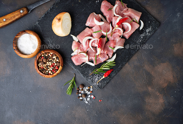Raw chopped meat with spices on rusty background - Stock Photo - Images