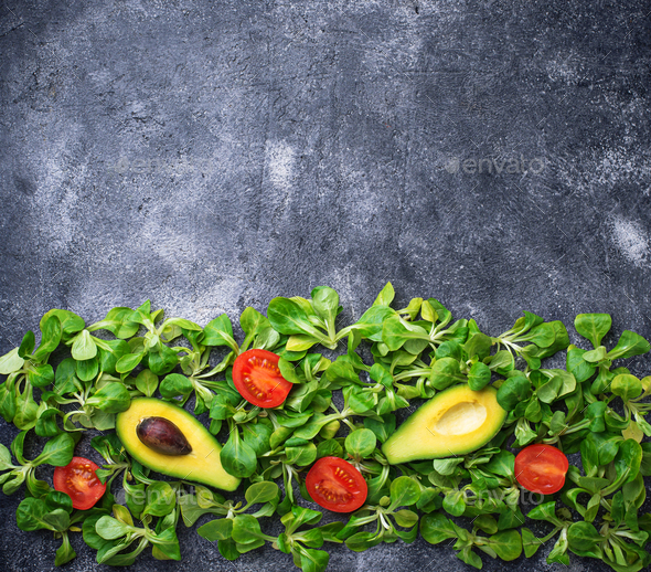 Green food background with corn lettuce, tomato and avocado - Stock Photo - Images