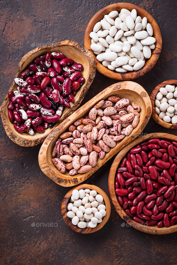 Assortment of various beans in wooden bowls - Stock Photo - Images