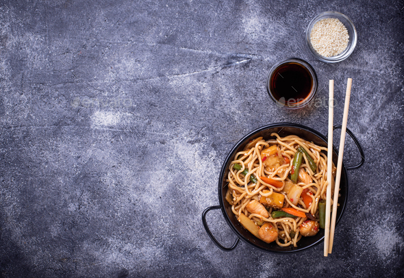 Stir fry noodles with chicken, tofu and vegetable. - Stock Photo - Images