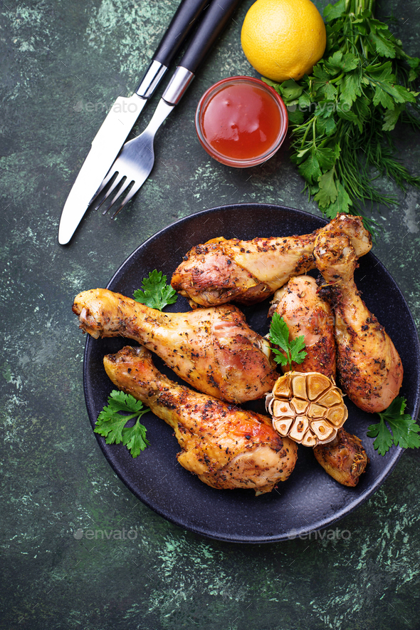 Grilled chicken legs with spices and garlic. - Stock Photo - Images