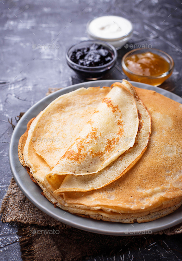 Pancakes crepes with different jam and cream - Stock Photo - Images