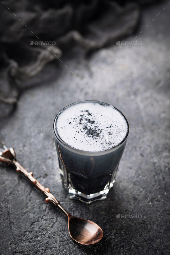 Black charcoal latte.  Detox drink. - Stock Photo - Images
