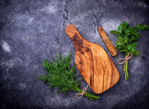 Dill, parsley and cutting board - Stock Photo - Images