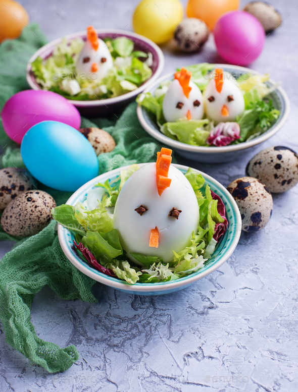 Salad with eggs in shape of chickens. Festive food. - Stock Photo - Images